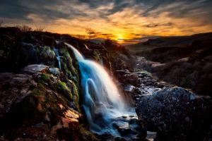boulders-cascade-clouds-462032